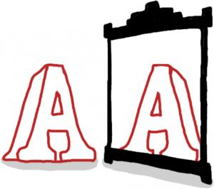 Letra reflejada en un espejo.